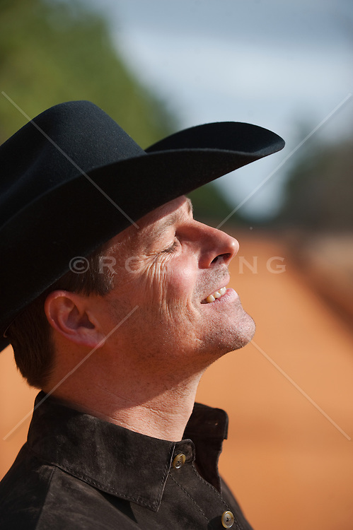 cowboy with his eyes closed enjoying the sun