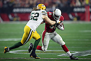 Arizona Cardinals rookie running back David Johnson (31) gets tackled by Green Bay Packers inside linebacker Clay Matthews (52) after catching a first quarter pass for no gain on the play during the NFL NFC Divisional round playoff football game against the Green Bay Packers on Saturday, Jan. 16, 2016 in Glendale, Ariz. The Cardinals won the game in overtime 26-20. (©Paul Anthony Spinelli)