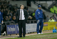 Derby Manager Billy Davies looks on as his side lose 0-2 to Stoke City
