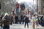 """A giant """"Crom"""" from the Macnas Street Theatre Company in Co. Galway makes its way along Piccadilly during the St Patrick's Day Parade in Westminster, London.<br /> Picture by Paul Davey/Focus Images Ltd +447966 016296<br /> 13/03/2016"""