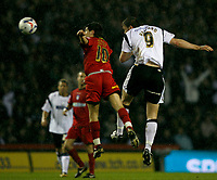 Steve Howard (right) heads for goal. Kem Izzet (left) defends