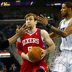 January 3, 2011; New Orleans, LA, USA; Philadelphia 76ers forward Andres Nocioni (5) drives between New Orleans Hornets power forward David West (30) and small forward Trevor Ariza (1) during the first quarter at the New Orleans Arena.   Mandatory Credit: Derick E. Hingle