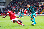 Swansea City midfielder Bersant Celina (10) and Barnsley defender Bambo Diaby (5) in action during the EFL Sky Bet Championship match between Barnsley and Swansea City at Oakwell, Barnsley, England on 19 October 2019.
