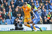 Preston North End forward Jordan Hugill (25) evades a tackle from Brighton & Hove Albion defender Gaetan Bong (12) during the Sky Bet Championship match between Brighton and Hove Albion and Preston North End at the American Express Community Stadium, Brighton and Hove, England on 24 October 2015. Photo by Phil Duncan.