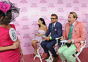 Celebrity judges Simon Baker, center, and Carson Kressley, right, along with Southern Living style editor Stefanie Granada, judge the Longines Kentucky Oaks Fashion Contest on Kentucky Oaks Day, Friday, May 2, 2014, in Louisville, Ky.  Longines, the Swiss watch manufacturer known for its luxury timepieces, is the Official Watch and Timekeeper of the 140th annual Kentucky Derby.  (Photo by Diane Bondareff/Invision for Longines/AP Images)