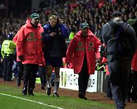 Photo. Richard Lane. <br />Aston Villa v Birmingham City. Barclaycard Premiership. 03/03/2003<br />Robbie Savage leaves the field under escort as Villa fans throw missiles.