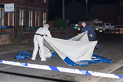 © Licensed to London News Pictures . 31/05/2013. Barlow Road , Levenshulme , Manchester , UK . Police and forensic scenes of crime examiners erecting a tent at the scene where a man was critically injured yesterday (Thursday 30th May) evening following an altercation in the street . He later died at Manchester Royal Infirmary . Greater Manchester Police have arrested three men and three women on suspicion of murder . Photo credit : Joel Goodman/LNP