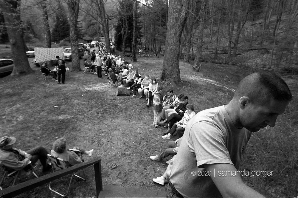 People wait in line for hours to eat a meal of ramps  at the annual Ramps Festival in Helvetia, West Virginia.