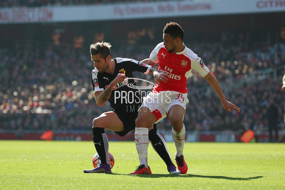 Watford midfielder, Valon Behrami (8) battling for bal with Arsenal midfielder, Francis Coquelin (34) during the The FA Cup Quarter Final match between Arsenal and Watford at the Emirates Stadium, London, England on 13 March 2016. Photo by Matthew Redman.