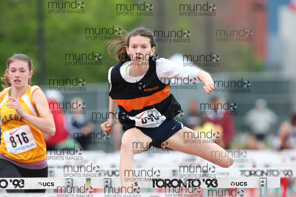 Madeline Whitestone of Harbord CI - Toronto competes in the sprint hurdle heats at the 2013 OFSAA Track and Field Championship in Oshawa Ontario, Thursday,  June 6, 2013.<br /> Mundo Sport Images / Sean Burges
