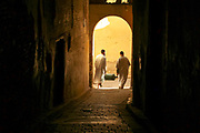 People walk through an alleyway in the Fez el Bali historic Medina, Morocco, 2013-11-01.<br />
