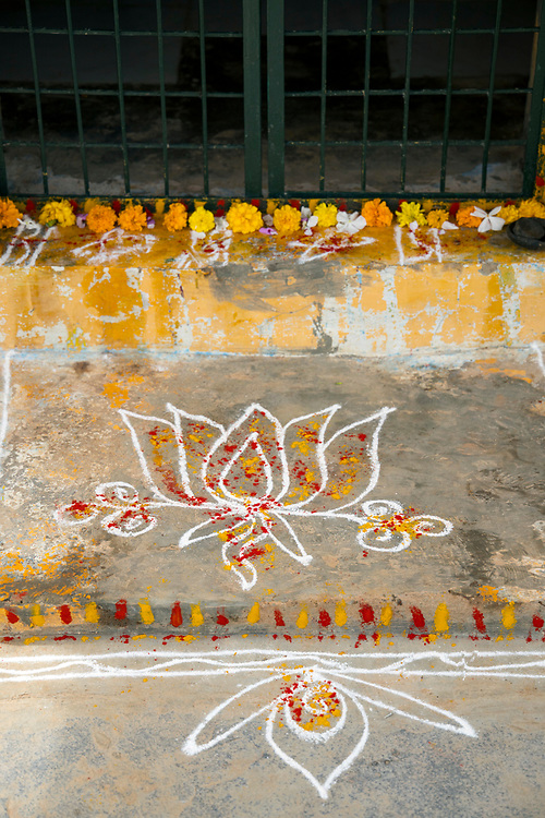 PUTTARPATHI, INDIA - 27th October 2019 - Pookalam / rangoli pattern on floor of entrance to home in Puttarpathi, Andhra Pradesh, South India