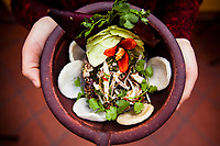 A bowl of banana flower salad, a popular Vietnamese dish, at Madame Hien restaurant in Hanoi, Vietnam.