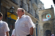 An local man walks in a street of the Northern Spanish Basque city of Bilbao, on August 25, 2011. Photo Rafa Rivas