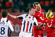 Onderwerp/Subject: FC Twente - Willem II - Eredivisie<br /> Reklame:  <br /> Club/Team/Country: <br /> Seizoen/Season: 2012/2013<br /> FOTO/PHOTO: Wout BRAMA (BEHIND) of FC Twente in duel with Nicky HOFS ( Nick HOFS ) (FRONT) of Willem II. (Photo by PICS UNITED)<br /> <br /> Trefwoorden/Keywords: <br /> #03 #04 $94 ±1355229149625 ±1355229149625<br /> Photo- & Copyrights © PICS UNITED <br /> P.O. Box 7164 - 5605 BE  EINDHOVEN (THE NETHERLANDS) <br /> Phone +31 (0)40 296 28 00 <br /> Fax +31 (0) 40 248 47 43 <br /> http://www.pics-united.com <br /> e-mail : sales@pics-united.com (If you would like to raise any issues regarding any aspects of products / service of PICS UNITED) or <br /> e-mail : sales@pics-united.com   <br /> <br /> ATTENTIE: <br /> Publicatie ook bij aanbieding door derden is slechts toegestaan na verkregen toestemming van Pics United. <br /> VOLLEDIGE NAAMSVERMELDING IS VERPLICHT! (© PICS UNITED/Naam Fotograaf, zie veld 4 van de bestandsinfo 'credits') <br /> ATTENTION:  <br /> © Pics United. Reproduction/publication of this photo by any parties is only permitted after authorisation is sought and obtained from  PICS UNITED- THE NETHERLANDS