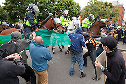 © Licensed to London News Pictures. 14/07/2012. Bristol , UK . Anti fascist protesters clash with police as they attempt to block the route for EDL supporters to leave their demontration . The English Defence League hold a march and demonstration in Bristol . Photo credit : Joel Goodman/LNP