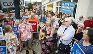 LisaBeth Weber leads the crowd in song during an anti racism vigil in support of Charlottesville Monday, August 14, 2017 in Newtown, Pennsylvania. After some speeches, the group walked to Newtown Friends Meetinghouse. (Photo by William Thomas Cain)