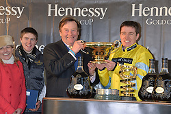 Left to right, NICKY HENDERSON and jockey BARRY GERAGHTY at the 2013 Hennessy Gold Cup at Newbury Racecourse, Berkshire on 30th November 2013.