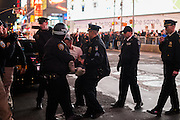 Nov. 25, 2014 - Manhattan, NY. Protestors took to Times Square to protest the grand jury's decision not to indict Darren Wilson in the shooting of Ferguson teen Michael Brown. 11/25/14 Photograph by Julius Constantine Motal/NYCity Photo Wire