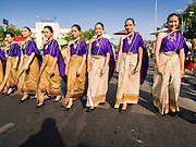 19 APRIl 2014 - BANGKOK, THAILAND:  People in traditional Thai dress from the 1800s walk in the parade at the Rattanakosin Festival in Bangkok. Rattanakosin is the name of the man made island that is the heart of the old city. Bangkok was formally founded as the capital of Siam (now Thailand) on 21 April 1782 by King Rama I, founder of the Chakri Dynasty. Bhumibol Adulyadej, the current King of Thailand, is Rama IX, the ninth King of the Chakri Dynasty. The Thai Ministry of Culture organized the Rattanakosin Festival on Sanam Luang, the royal parade ground in the heart of the old part of Bangkok, to celebrate the city's 232nd anniversary.   PHOTO BY JACK KURTZ