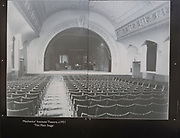 Public display of old historic images about the GWR works, Swindon, Wiltshire, England, UK interior of Mechanics' Institute 1931 showing the main stage