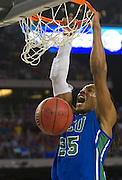 Sherwood Brown (25) of the Florida Gulf Coast University Eagles dunks the ball against the University of Florida Gators during the NCAA South Regionals at Cowboys Stadium in Arlington on Friday, March 29, 2013. (Cooper Neill/The Dallas Morning News)