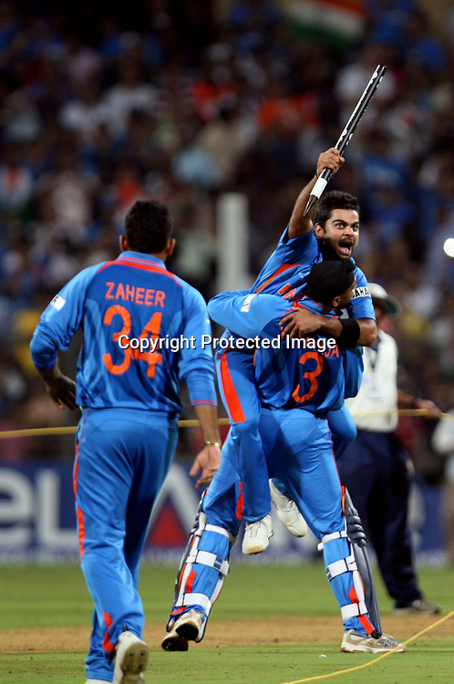 Indian players celebrate winning the final against Sri Lanka at the ICC Cricket World Cup - Final India vs Sri Lanka Played at Wankhede Stadium, Mumbai.2 April 2011 - day/night (50-over match)
