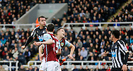 Steven Taylor (l) of Newcastle United heads in the opening goal during the Barclays Premier League match at St. James's Park, Newcastle<br /> Picture by Simon Moore/Focus Images Ltd 07807 671782<br /> 01/01/2015