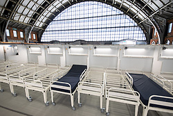 © Licensed to London News Pictures. 11/04/2020. Manchester, UK. Beds are placed on a ward in the hospital . The National Health Service is building a 648 bed field hospital for the treatment of Covid-19 patients , at the historical railway station terminus which now forms the main hall of the Manchester Central Convention Centre . The facility is due to open on Easter Monday , 13th April 2020 , and will treat patients from across the North West of England , providing them with general medical care and oxygen therapy after discharge from Intensive Care Units . Photo credit: Joel Goodman/LNP