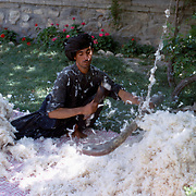 June 1969<br /> At certain times of the year roving specialists moved through residential streets ready to provide household needs. Spring brought out experts for fluffing cotton to fill mattresses used for sitting and sleeping.