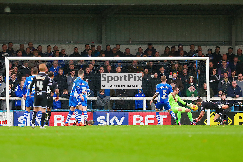 Jason Pearce scores the opening goal for Wigan Athletic during Rochdale v Wigan Athletic , Sky Bet League One Match, 14 November 2015<br /> Picture by Jackie Meredith/SportPix.org.uk