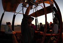 NAMIBIA SOSSUSVLEI 21APR14 - Pilot Eric Hesemans launches his balloon during a flight with Namib Sky Balloon Safaris in Sossusvlei, Namib Desert, Namibia.<br />