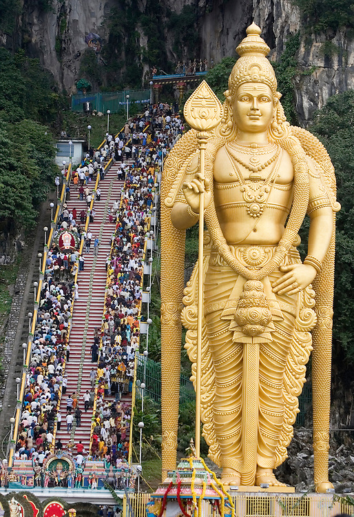 "Hindu devotees walk up the stairs to the sacred Batu Caves temple during the Thaipusam festival in Kuala Lumpur, Malaysia. Hindu devotees celebrate Thaipusam festival in honour of the Lord Murugan (also known as Lord Subramaniam). Thousands of Hindu devotees carried the milk pots and ""kavadi"" (a gaily decorated wooden or metal frame) walk barefoot up the temple's 272 steps to undergo penance in fulfilling vows made to Lord Murugan for answering their prayers."