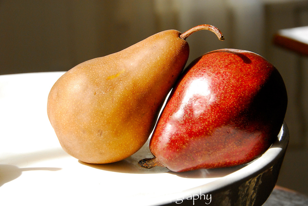 Gold and read pears on white plate,still life photography