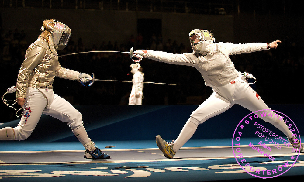 (L) ALEJANDRA ROMERO BENITEZ (SPAIN) & (R) BOGNA JOZWIAK (POLAND) AT WOMAN'S INDIVIDUAL SABRE COMPETITION ROUND OF 32 DURING THE BEIJING 2008 SUMMMER OLYMPICS GAMES IN BEIJING, CHINA.. .CHINA , BEIJING , AUGUST 9, 2008..( PHOTO BY ADAM NURKIEWICZ / MEDIASPORT )..PICTURE ALSO AVAIBLE IN RAW OR TIFF FORMAT ON SPECIAL REQUEST.