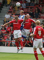 Photo: Paul Thomas.<br /> Nottingham Forest v Huddersfield. Coca Cola Championship.<br /> 06/08/2005.<br /> <br /> Andy Booth out jumps Nicky Southall and Danny Cullip.