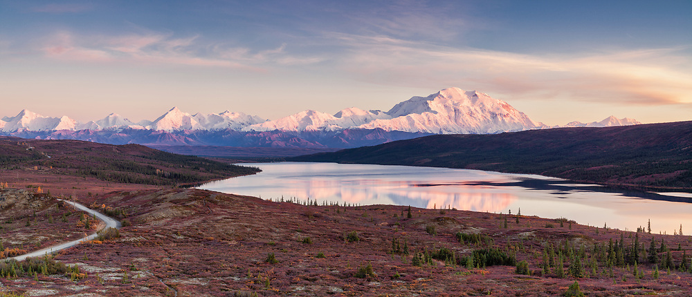 Composite panorama of alpenglow on Denali (Mt. McKinley) and the Alaska Range with Wonder Lake in foreground in Denali National Park in late fall in Southcentral Alaska. Evening.