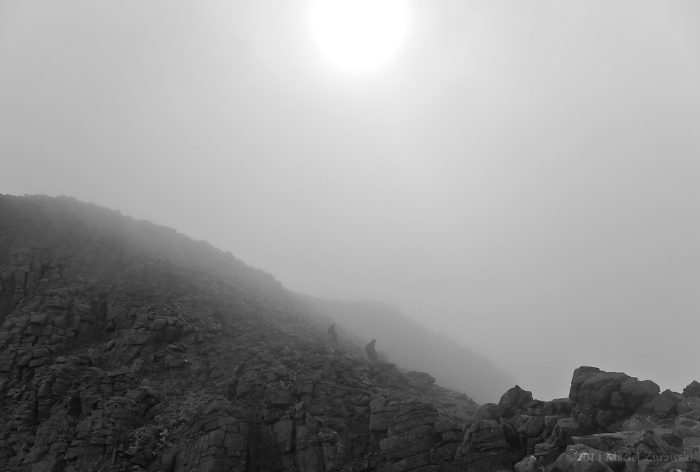 Sun shining through the fog in the Quinag mountain range in Sutherland, Scotland.