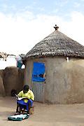 Balila doing her homework at her home in Tinguri, Ghana.