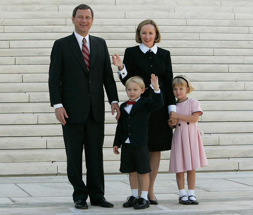 10/3/2005 -- Washington, DC, U.S.A -- New Supreme Court Chief Justice John Roberts, wife Jane, son Jack, 4, and daughter Josie, 5, pose for photographs in front of the court after Roberts' investiture ceremony Monday morning.    Photo by H. Darr Beiser, USA TODAY staff  (Via MerlinFTP Drop)