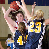 (SPORTS) Wall Twp 1/31/2004  Wall Twp's #55 Mandi Pierson get double team by TRN's #44 Kelly Healey and # 23 Ashley Reinecke (sp?)  Michael J. Treola Staff Photographer..........MJT