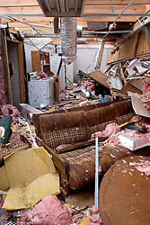 25 Sept, 2005.  Cameron, Louisiana. Hurricane Rita aftermath. <br /> Inside a residence alongside the canal, smashed by the storm.<br /> Photo; &copy;Charlie Varley/varleypix.com