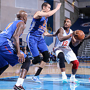 Delaware 87ers Guard Maalik Wayns (12) drives towards the basket as Westchester Knicks Center Ben Strong (8) defends in the first half of a NBA D-league regular season basketball game between the Delaware 87ers and the Westchester Knicks (New York Knicks) Wednesday, Feb. 17, 2015 at The Bob Carpenter Sports Convocation Center in Newark, DEL
