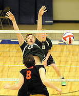 Pennridge's Aaron Nelson #27 misses a volley from Hempfield's Cole Rineer #9 during the first round PIAA state volleyball game between Hempfield and Pennridge at Quakertown High School Wednesday May 27, 2015 in Quakertown, Pennsylvania. Hemp field defeated Pennridge 3-0. (Photo by William Thomas Cain/Cain Images)