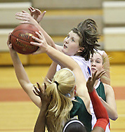 Washington's Abby Herb (top) tries to knock a rebound away from West's Shelly Stumpff (back towards camera) during the girl's high school basketball game between Iowa City West and Cedar Rapids Washington at Washington High School, 2205 Forest Drive SE, in Cedar Rapids, on Tuesday evening, January 3, 2012. (Stephen Mally/Freelance)