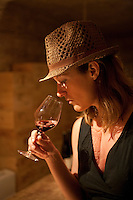 Birgit tasting wine in a cave in Cahteauneuf-des-Papes