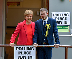 SNP leader Nicola Sturgeon with SNP candidate Alex Kerr at her local polling station in Glasgow after casting her vote in the European elections.<br /> <br /> © Dave Johnston / EEm