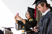 Ashley Osborne, a strategic communication major, takes a selfie before the start of the morning Undergraduate Commencement ceremony on Saturday, May 2, 2015.  Photo by Ohio University  /  Rob Hardin