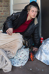 """Rough sleeper Stephanie, 34, as her pitch outside the post office on Peascod Street. After a public outcry against their """"homelessness support strategy"""" where rough sleepers would have been fined £100, Windsor council has shelved their plans. Windsor, Berkshire, February 16 2018."""