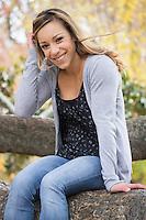 Portrait of a woman sitting in a tree in Piedmont Park, Atlanta
